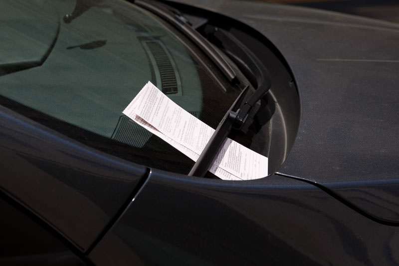 Two Parking Tickets on Car Windshield, Washington DC, USA