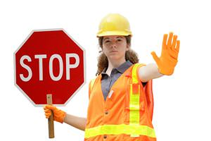 construction-worker-holding-stop-sign