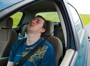 man-sleeping-in-car