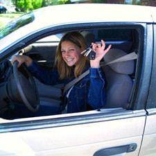 Smiling driver holding car key