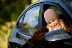 Young blonde woman driver